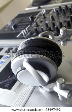 Audio Mixing Console with headphones - stock photo
