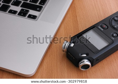 Audio recorder and laptop. Close up.