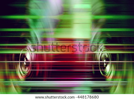 Audio speakers with blured red and green light streaks
