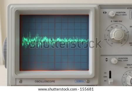 Audio waveform displayed on oscilloscope - stock photo