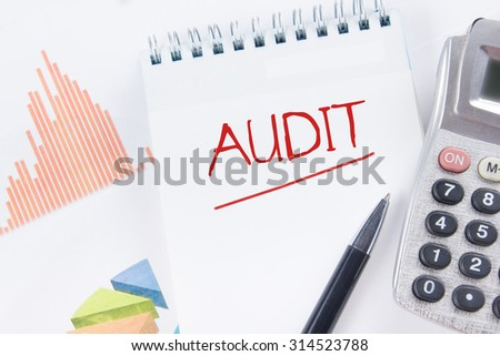 Audit concept - Financial accounting stock market graphs analysis. Calculator, notebook with blank sheet of paper, pen on chart. Top view - stock photo