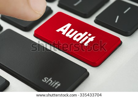 Audit red keyboard button with female hand try to enter it - financial, business, online and data concept - stock photo