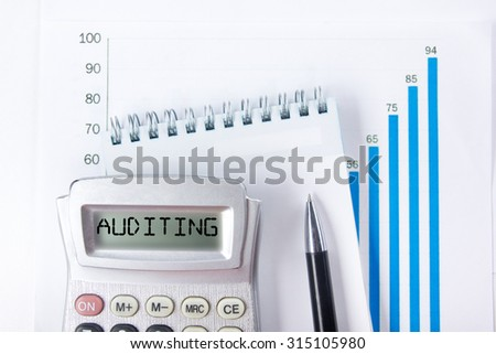Auditing - Financial accounting stock market graphs analysis. Calculator, notebook with blank sheet of paper, pen on chart. Top view - stock photo