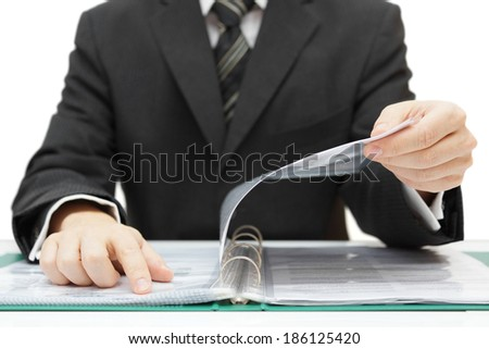 auditor checking documentation - stock photo