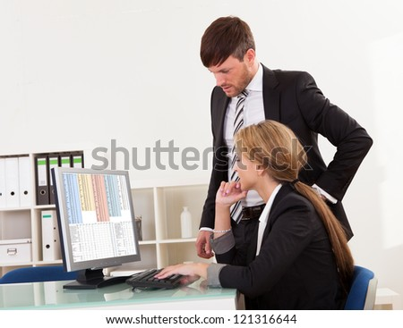 Auditor explaining account processes for year-end report. - stock photo