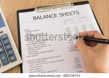 Auditors audited the financial statements that conform to accounting standards. - stock photo