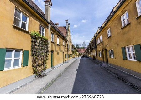 AUGSBURG, GERMANY - APRIL 29, 2015: The Fuggerei is the worlds oldest social housing complex still in use in Augsburg, Germany.
