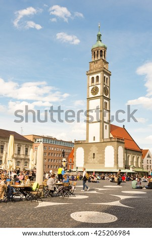 AUGSBURG, GERMANY - APRIL 30: Tourists at a street cafe in Augsburg, Germany on April 30, 2016. Augsburg is one of the oldest cities of Germany.  Foto taken from Rathausplatz. - stock photo