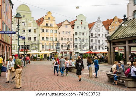 AUGSBURG, GERMANY - AUGUST 19: People at the historic center of Augsburg, Germany on August 19, 2017. Augsburg is one of the oldest cities of Germany.