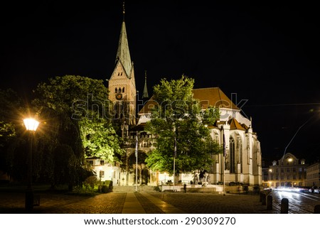 AUGSBURG, GERMANY - JUNE 20, 2015: The beautiful cathedral of Augsburg is illuminated at night during the festival â??the long night of lightsâ? in Augsburg, Germany. Augsburg is an ancient roman city - stock photo