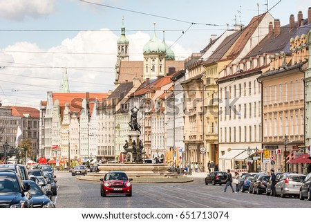 AUGSBURG, GERMANY - MAY 20: People and cars on a street in Augsburg, Germany on May 20, 2017. Augsburg is one of the oldest cities of Germany. Photo taken from Maximilianstrasse
