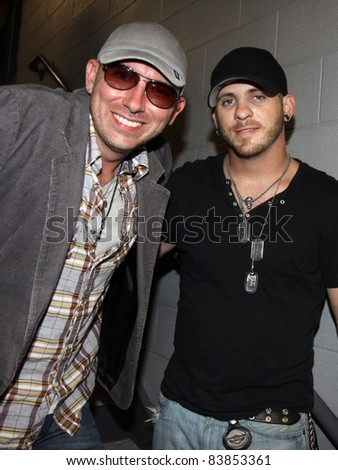 "August 16, 2011 - Athens, GA - Corey Smith and Brantley Gilbert. At a benefit for the family of Elmer ""Buddy"" Christian. - stock photo"