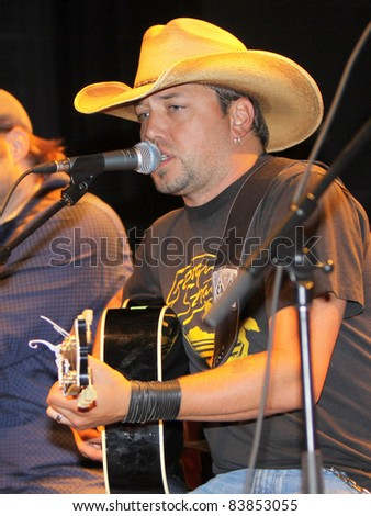 "August 16, 2011 - Athens, GA - Jason Aldean. At a benefit for the family of Elmer ""Buddy"" Christian. - stock photo"