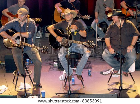 """August 16, 2011 - Athens, GA - (l-r) James Otto, Jason Aldean and Colt Ford. At a benefit for the family of Elmer """"Buddy"""" Christian. - stock photo"""