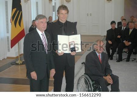 AUGUST 14, 2006 - BERLIN: Horst Koehler, Jens Lehmann, Wolfgang Schaeuble at a reception for the German national soccer team after the world championship, Schloss Bellevue, Berlin. - stock photo