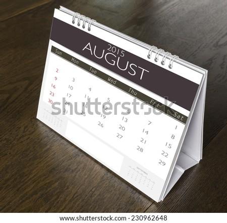 August Calendar  2015 on wood table - stock photo