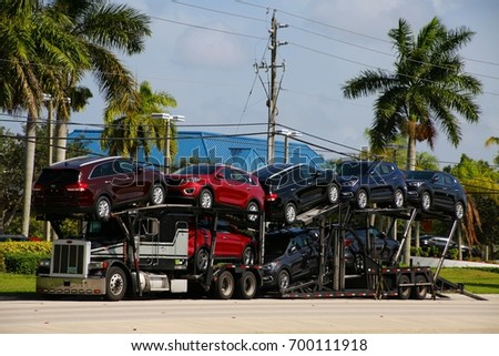 August 3 2016 deerfield beach fl stock photo 700111918 shutterstock august 3 2016 deerfield beach fl a car carrier truck carrying the latest models solutioingenieria Choice Image