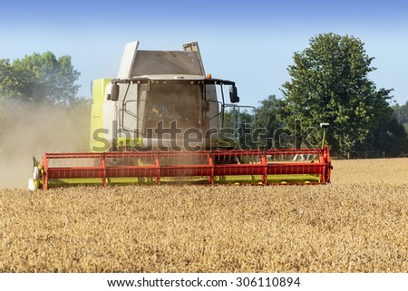 August 13, 2015, Germany near the town Dassow combine harvester on a wheat field, agricultural scene - stock photo