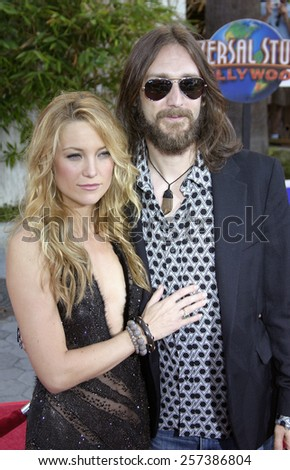 "August 2, 2005. Kate Hudson and husband Chris Robinson at the ""The Skeleton Key"" Los Angeles Premiere at the Universal Studios Cinema in Hollywood, California. - stock photo"