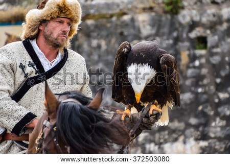 "August 26,2015 :Kazakh  hunter in the show ""Les Aigles Des Remparts"" by VOL LIBRE Production in Provins,France."