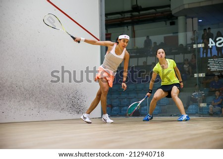 AUGUST 19, 2014 - KUALA LUMPUR, MALAYSIA: Nicol David of Malaysia (front) hits a return in her match against Liu Tsz-Ling of Hong Kong (yellow) in the CIMB Malaysian Open Squash Championship 2014.