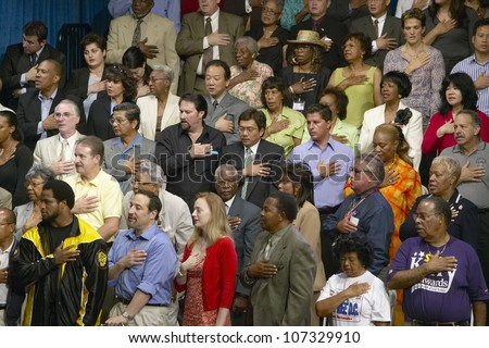 AUGUST 2004 - Multi-cultural crowd reciting Pledge of Allegiance at Kerry Campaign rally, CSU- Dominguez Hills, Los  Angeles, CA