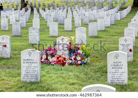 August 2nd, 2016 Arlington VA: Arlington National Cemetery the grave of Humayun Saqib Muazzam Khan with a large number of flowers. Captain Khan entered the news after the 2016 DNC Convention.