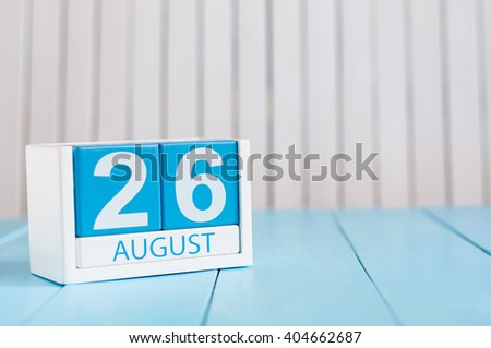 August 26th. Image of august 26 wooden color calendar on blue background. Summer day. Empty space for text