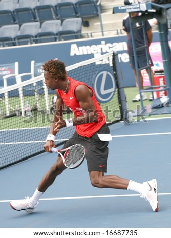 August 25, 2008 - US Open, New York: Gael Monfils of France hitting a backhand volley at the 2008 US Open during a first round match against Pablo Cuevas of Uruguay - stock photo