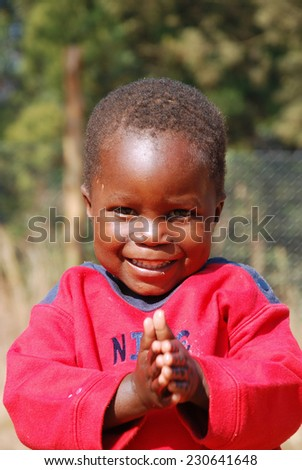 August 2014-Village of Pomerini-Tanzania-Africa Many African children with AIDS are helped by the Friars of the Franciscan Mission to give them medicine, a smile and a possible future - stock photo