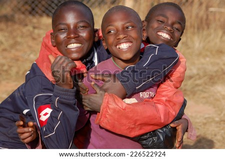 August 2014-Village of Pomerini-Tanzania-Africa-Smile to Africa Onlus-A smile of hope on the faces of African children of the Village of Pomerini hard-hit by AIDS-A smile for a possible future - stock photo