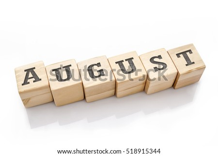 AUGUST word made with building blocks isolated on white