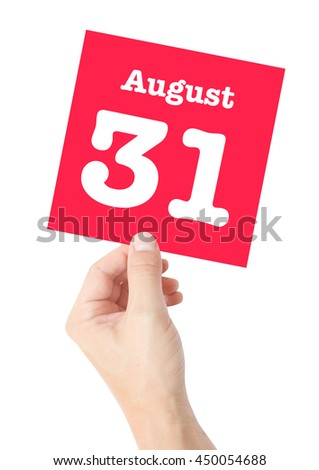 August 31 written on a card held by a hand - stock photo