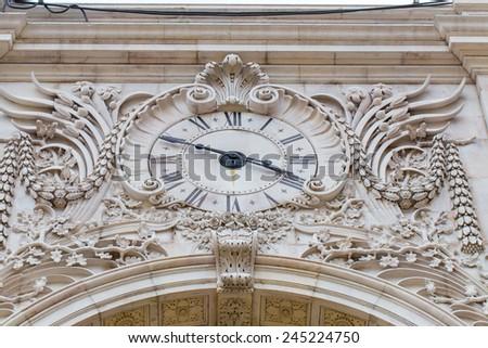 Augusta street clock in center of Lisbon, Portugal - stock photo