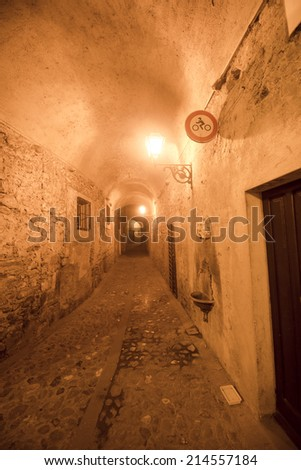 Aulla (Massa e Carrara, Tuscany, Italy), historic town in Lunigiana. Covered alley at evening
