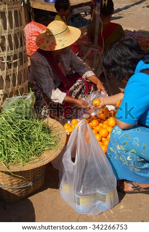 AUNG BAN, BURMA - FEB 28, 2015 - Local Shan women at the weekly market in  Aung Ban,  Myanmar (Burma)