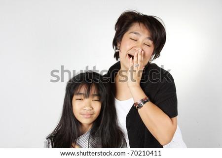 Auntie and her granddaughter feel sleepy. - stock photo