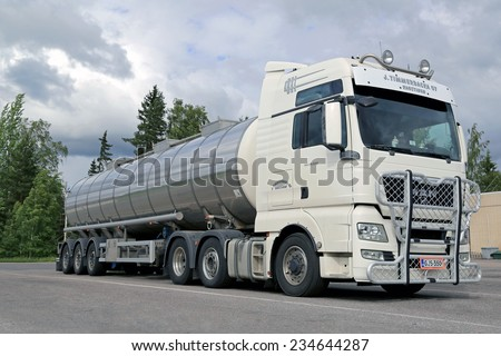 AURA, FINLAND - JUNE 20, 2014: White Man TGX 26.540 tank truck with bull bar parked on a yard. MAN ranks among the most sustainable vehicle and engineering companies worldwide.