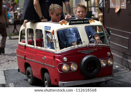 AURILLAC, FRANCE - AUGUST 24:  a very small and funny bus at the Aurillac International Street Theater Festival,company Delinus, on august 24, 2012, in Aurillac,France. - stock photo