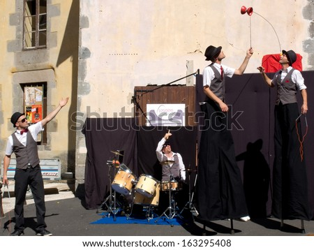 AURILLAC, FRANCE - AUGUST 22: Actors playing diabolo and walking on stilts  as part of the Aurillac International Street Theater Festival, Cie Kiblos,on august 22, 2013, in Aurillac,France  - stock photo