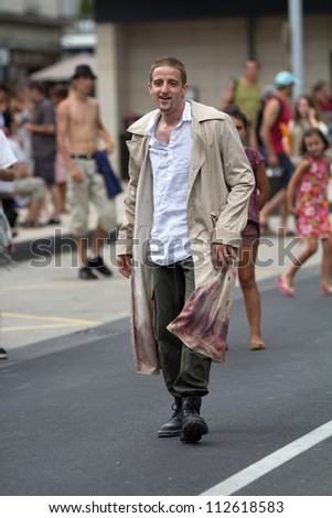 AURILLAC, FRANCE - AUGUST 23: an unidentified actor announces his show in the street as part of the Aurillac International Street Theater Festival, on august 23, 2012, in Aurillac,France.