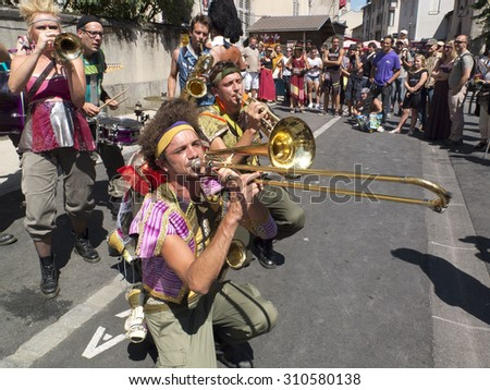 AURILLAC, FRANCE - AUGUST 19: Brass band playing in the street, as part of the Aurillac International Street Theater Festival, on august 19, 2015, in Aurillac,France.