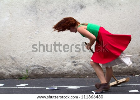 AURILLAC, FRANCE - AUGUST 24 : dancer holding a broom as part of the Aurillac International Street Theater Festival,show by the Company D'Akipaya Danza , on august 24, 2012, in Aurillac,France. - stock photo