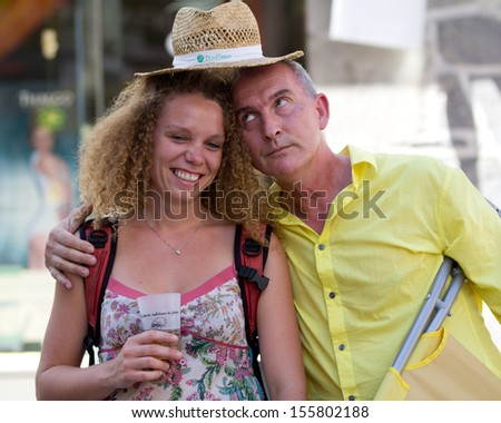AURILLAC, FRANCE - AUGUST 22: Funny couple in the street as part of the Aurillac International Street Theater Festival, Cie Groupe Bernard Menaut,on august 22, 2013, in Aurillac,France  - stock photo