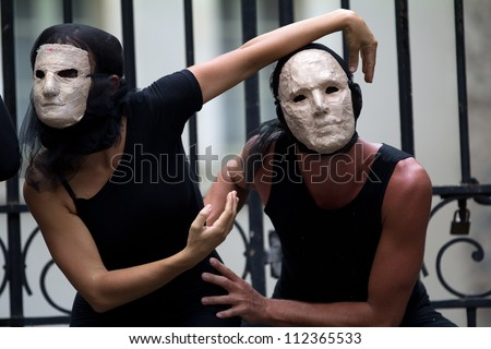 AURILLAC, FRANCE - AUGUST 23: mysterious actors wearing a white mask as part of the Aurillac International Street Theater Festival, show La diagonale du Fou, on august 23, 2012, in Aurillac,France.