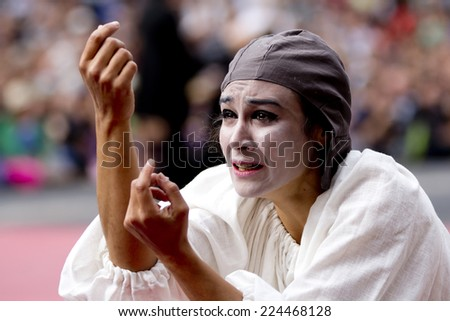 AURILLAC, FRANCE-AUGUST 22: portrait of an expressive and sad actress as part of the Aurillac International Street Theater Festival, cie teatro del silencio ,on august 22, 2014, in Aurillac,France.  - stock photo