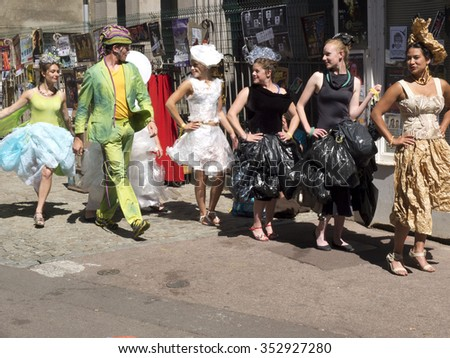 AURILLAC, FRANCE - AUGUST 19: some artists organize a fashion show parody in the street, as part of the Aurillac International Street Festival, on august 19, 2015, in Aurillac, France.