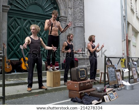 AURILLAC, FRANCE- AUGUST 20: some funny street performers play as part of the Aurillac International Street Theater Festival, show by cie les trois coups,on august 20, 2014, in Aurillac,France.  - stock photo