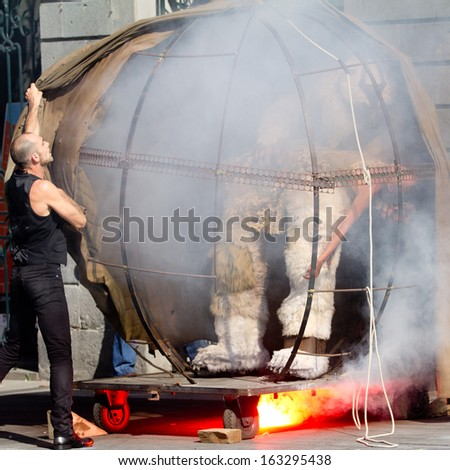 AURILLAC, FRANCE - AUGUST 21: Strange smoking machine as part of the Aurillac International Street Theater Festival, cie Theatre du Vertige,on august 21, 2013, in Aurillac,France  - stock photo