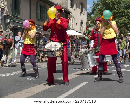 AURILLAC, FRANCE, AUGUST 21: street artists inflate balloons as part of the Aurillac International Street Theater Festival, cie les Bryans brothers and sisters, on august 21, 2014 in Aurillac, France. - stock photo